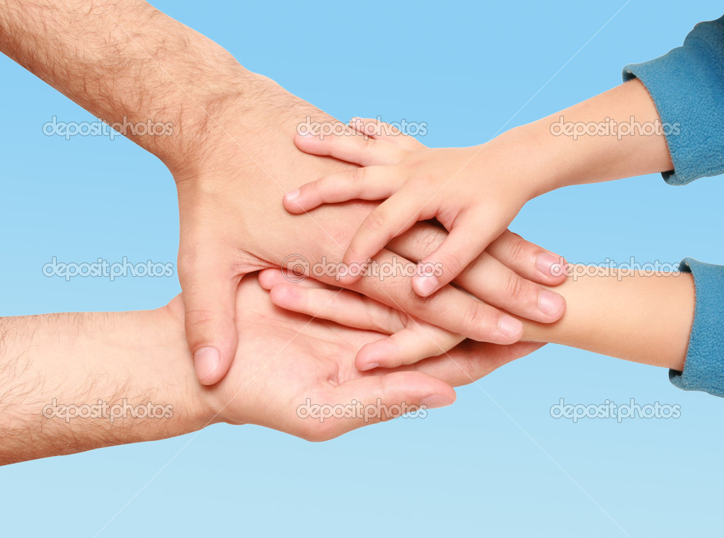 Hands of the child in the hands of an adult male — Stock Photo #1280263