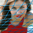 Woman for the football net — Stock Photo