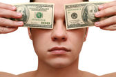 Hombre cierra sus ojos con dinero — Foto de Stock