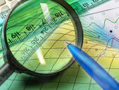 Graphic, magnifier, ruler and calculator — Stock Photo