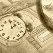 Royalty-Free Stock Photo: Graphic, magnifier, money and clock