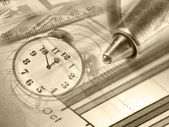 Pen, magnifier, money and clock — Stock Photo