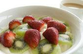 Fruit and yoghurt breakfast — Stock Photo