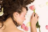 Beauty woman sleep with rose — Stock Photo