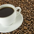 Black coffee and beans — Stock Photo