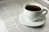 Coffee and newspaper in the morning — Stock Photo