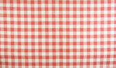 Red and white gingham tablecloth pattern — Stock Photo