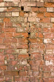 The damaged brick wall. — Stock Photo