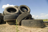 Heap worn out automobile tyre covers. — Stock Photo