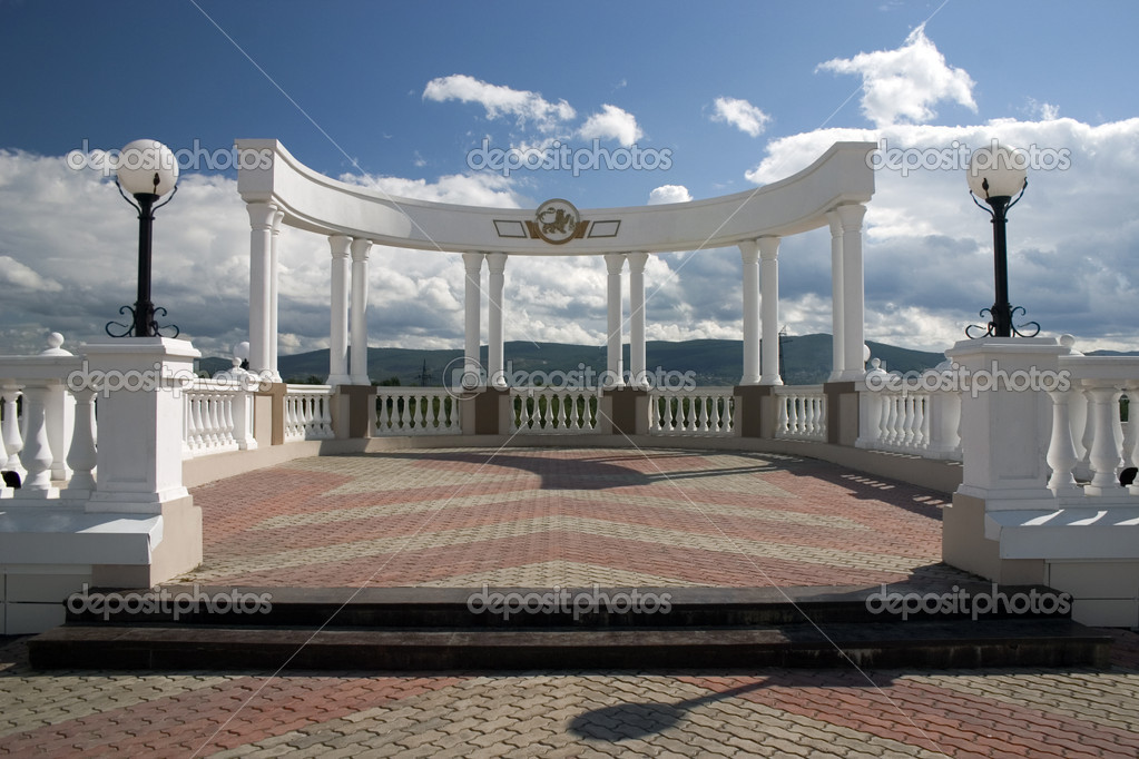 Balcony with white columns on a background of the sky with clouds. — Stock Photo #1415350