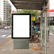 Board on bus stop — Stock Photo