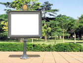 Publicity board on a park — Stock Photo