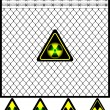 Stock Vector: Wire mesh fence and radiation sign