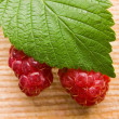 Raspberry on wooden background — Stock Photo