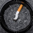 Cigarette in ashtray — Stock Photo #1303123