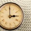 Clock with Roman numerals on cord - Stockfoto