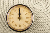 Clock with Roman numerals on cord — ストック写真