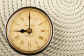 Clock with Roman numerals on cord — Stock Photo