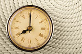 Clock with Roman numerals on cord — Stockfoto