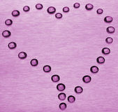 Drops in the form of heart — Stock Photo