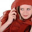 Woman in red headscarf — Stock Photo