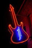 Red neon guitar — Stock Photo