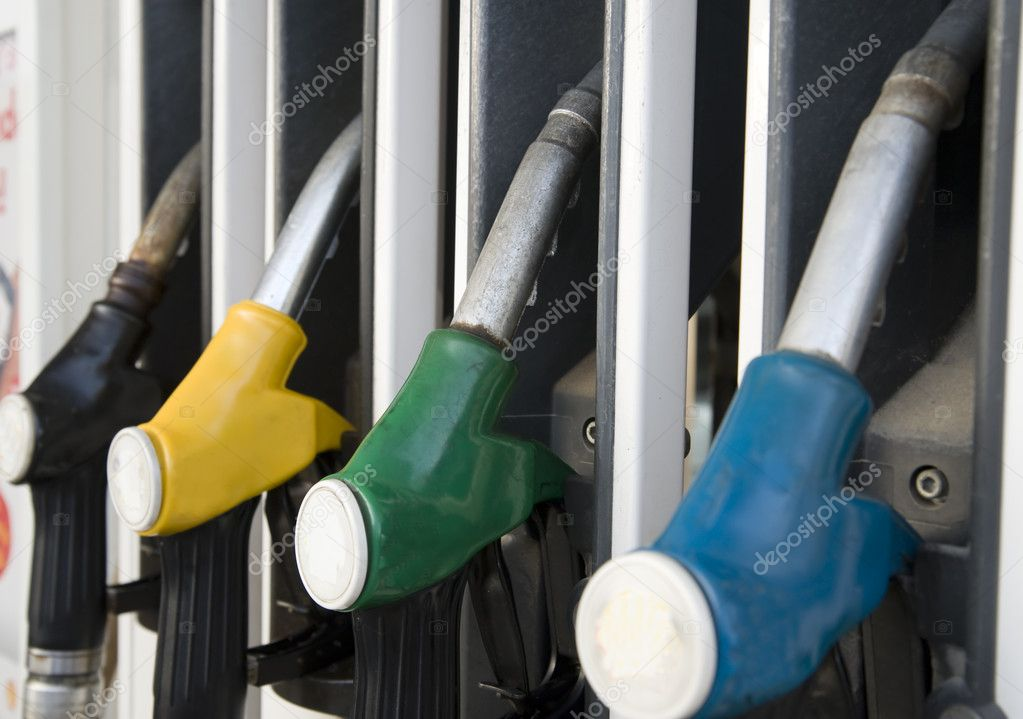 Fuelling nozzles on gasoline filling station — Stock Photo #1285861