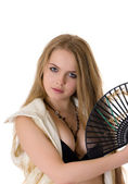 Blonde with a black fan — Stock Photo