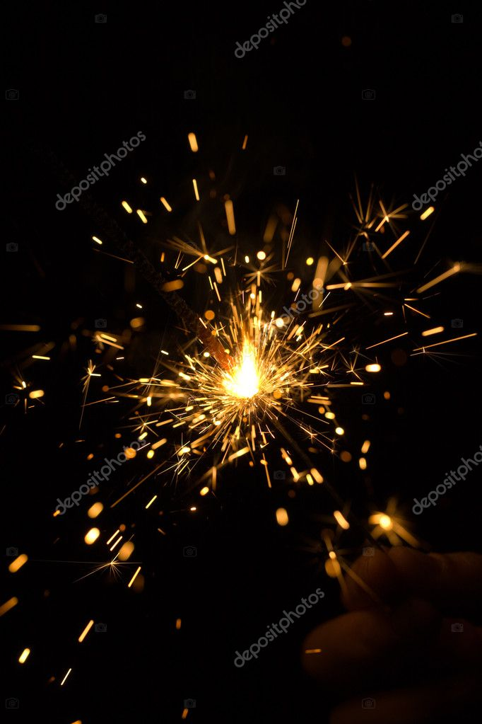 Sparking Bengal fire in hand on black background  Stock Photo #1288606