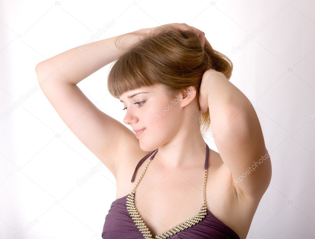 Portrait of the beautiful girl correcting a hairdress — Stock Photo #1296337