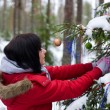 Girl decorates fir-tree — Stock Photo