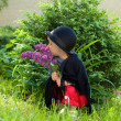 Petite girl on nature with flower — Stock Photo