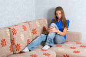 Beautiful girl on couch — Stock Photo