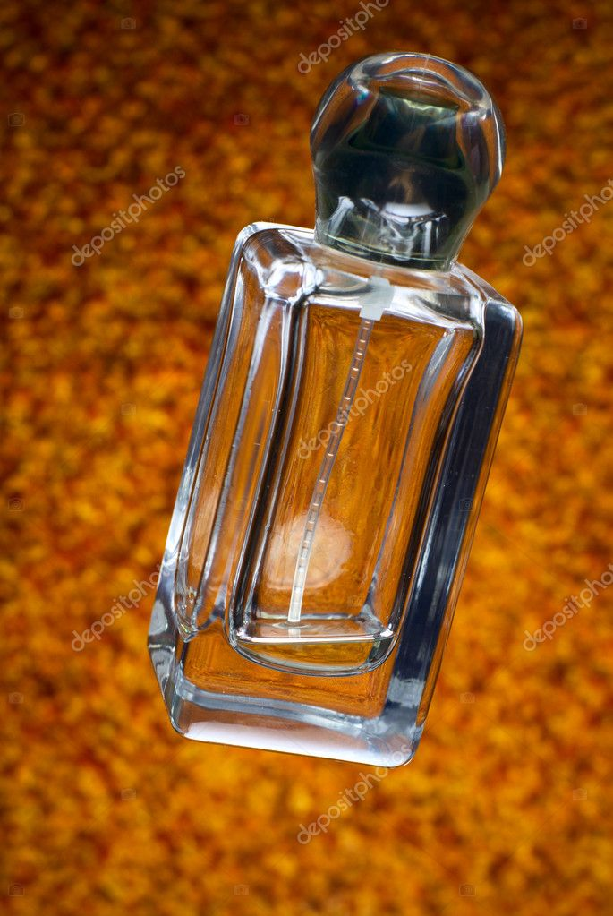 Glass vial with perfumes on golden background — Stock Photo #1303383