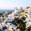 Small town Oia on Santorini, Greece - Stock Photo