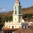 Belltower in the old town Trinidad, Cuba - Stock Photo