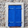 Window with blue shutter - Stock Photo