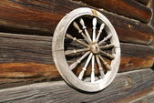 Wheel on a timbered wall — Stock Photo