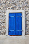Window with blue shutter — Stock Photo
