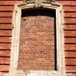 The old window immured by a bricklaying — Stock Photo