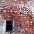 Red brick wall with close window — Stock Photo