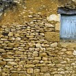 Stock Photo: Old yellow stone wall with close window