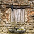 Old yellow stone wall,  close window — Stock Photo