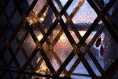 Medieval window in winter evening — Stock Photo