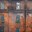 Stock Photo: Red brick wall with mosaic windows