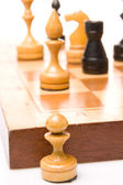 Chessmen on a chessboard — Stock Photo