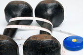 Old iron dumbbells and tape measure — Stock Photo