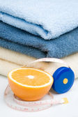 Pile of towels, tape and orange — Stock Photo