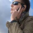 Young man speaks on the phone — Stock Photo