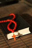Bible with red cross — Stock Photo